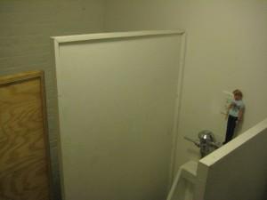 ShapeShifter Lab men's room still needs paint.