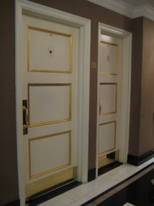 The Carlyle restroom doors, wide and narrow